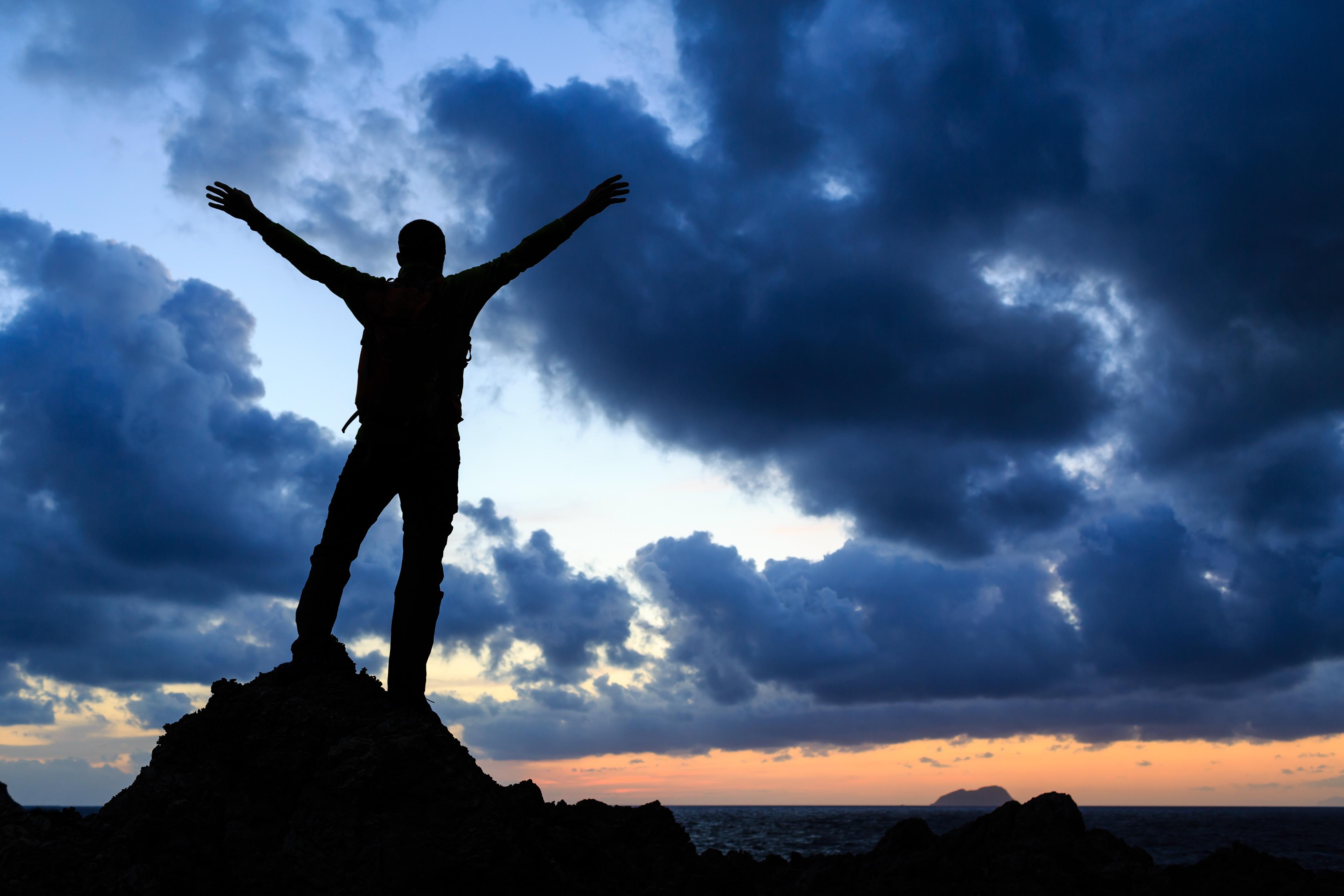 happy-winner-reaching-life-goal-success-man-P7VKMH2
